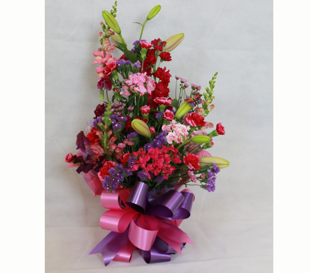 Front facing arrangement of Mixed Flowers and Colours
