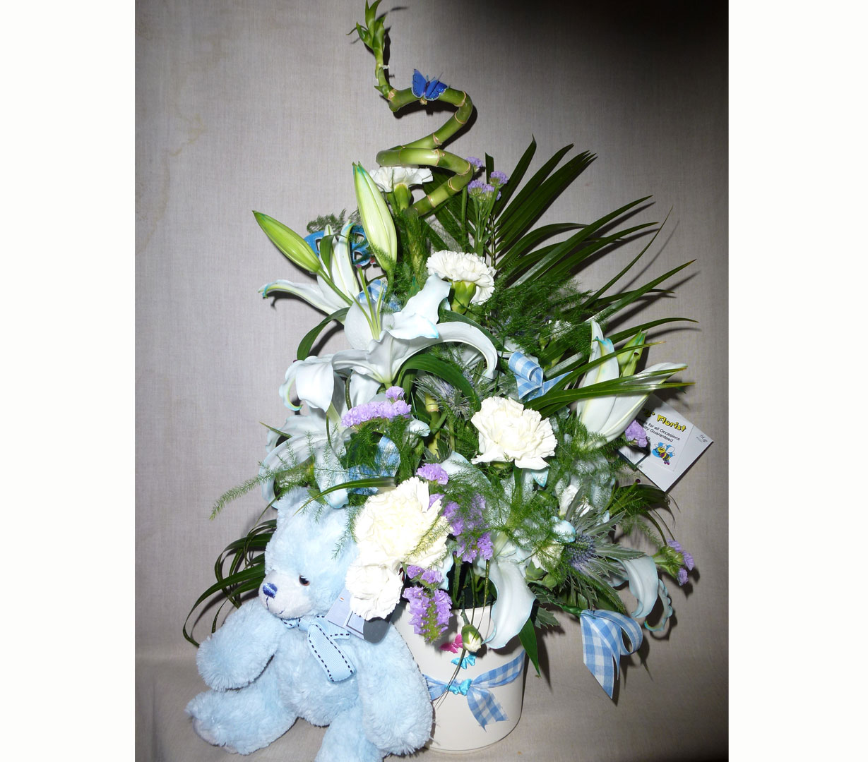 Blue Teddy Bear with Large Blue and White Flower arrangement