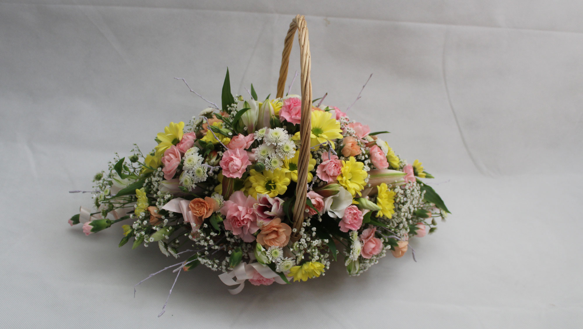 LONG AND LOW WICKER BASKET ARRANGEMENT